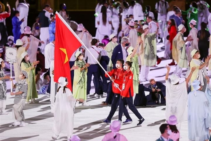 Võ sĩ Tonga cởi trần lại gây sốt khai mạc Olympic - 7