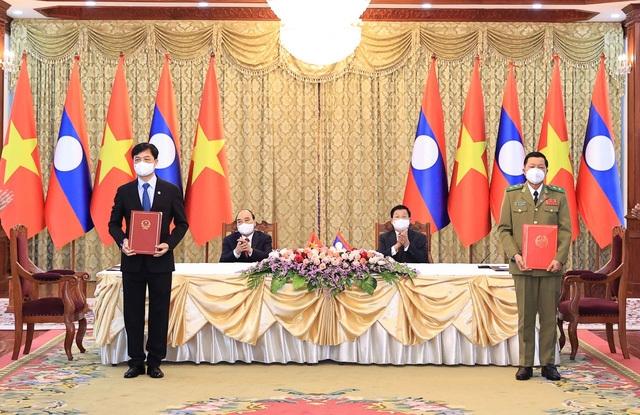 Việt Nam- Lào ký kết 14 văn kiện hợp tác - 1