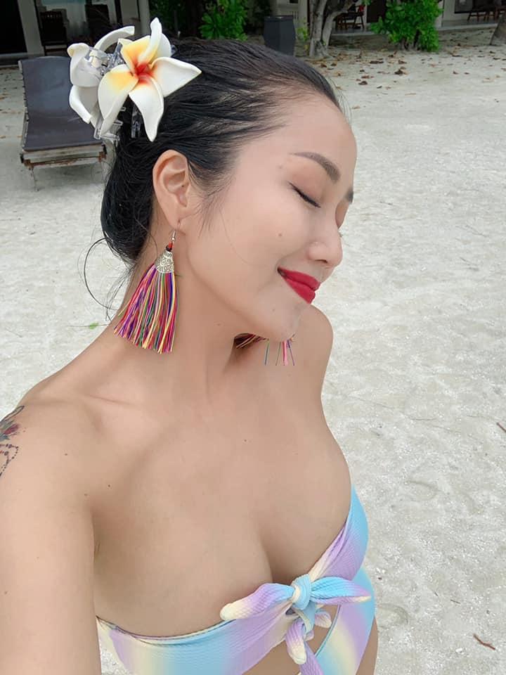 oc thanh van mac bikini khoe vong 1 dot mat tinh tu ben chong