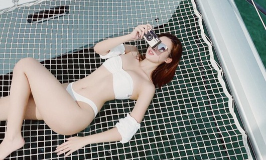 hoa hau do my linh va nhung lan hiem hoi dien bikini ho bao