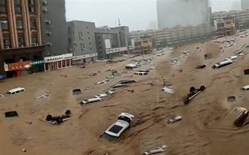Ảnh: Lũ lụt, nắng nóng kỷ lục tấn công khắp thế giới