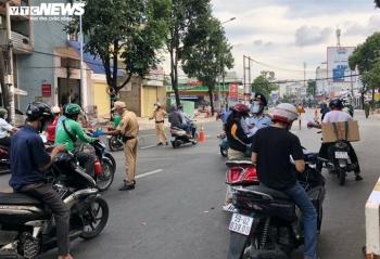 TP.HCM: Nhiều chốt kiểm soát dịch tạm dừng khai báo 'di biến động dân cư'