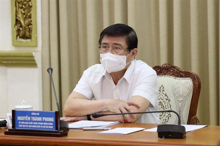 Chủ tịch TP.HCM: Sẽ quyết định việc giãn cách xã hội trong 5 ngày tới - 1