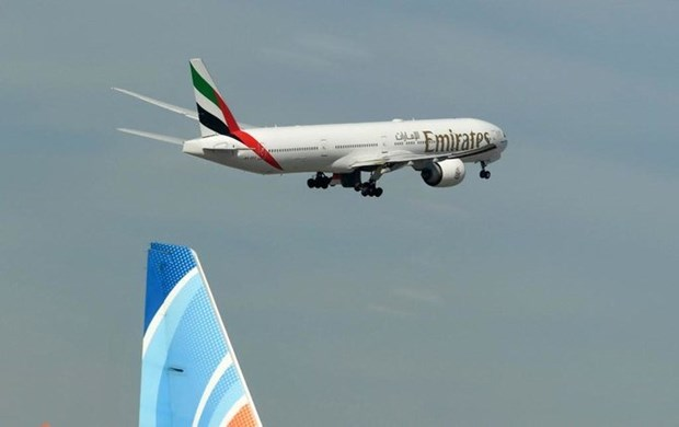 khach di may bay cua emirates duoc tra chi phi y te neu mac covid 19