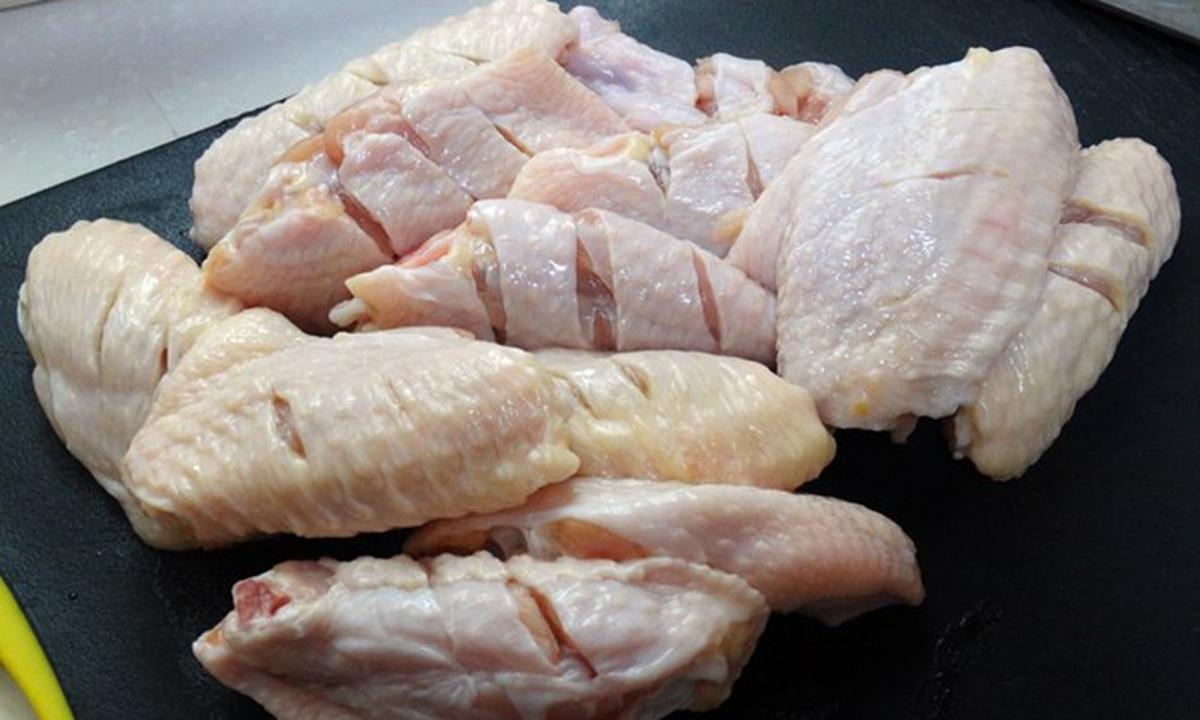 Ngày 13/8, giới chưc Thâm Quyến phát hiện mẫu cánh gà nhập khẩu từ Brazil có chứa nCoV. Ảnh: VCG