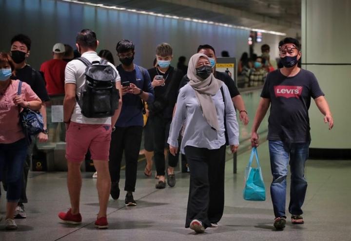 Sống chung với COVID-19, Singapore có thể ghi nhận tới 1.000 ca bệnh/ngày  - 2