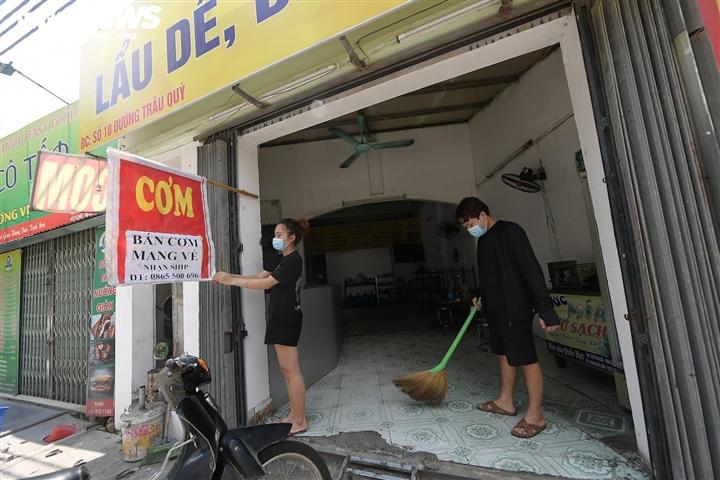 Hàng quán 'vùng xanh' Hà Nội háo hức chờ ngày được bán 'bình thường mới' - 10