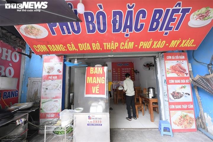 Hà Nội cho phép dịch vụ ăn, uống được bán mang về tại một số địa bàn 'vùng xanh' - 1