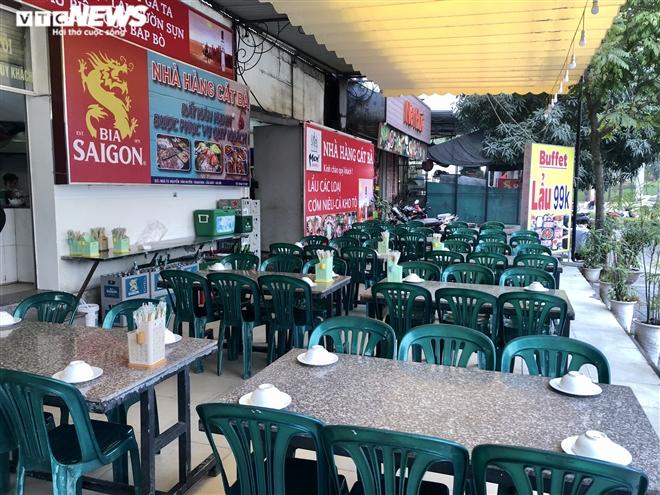 Điêu đứng giữa COVID-19, nhiều hàng quán Hà Nội đóng cửa nghỉ Tết sớm  - 1