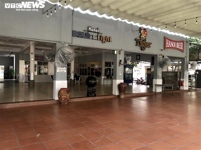 Điêu đứng giữa COVID-19, nhiều hàng quán Hà Nội đóng cửa nghỉ Tết sớm  - 12