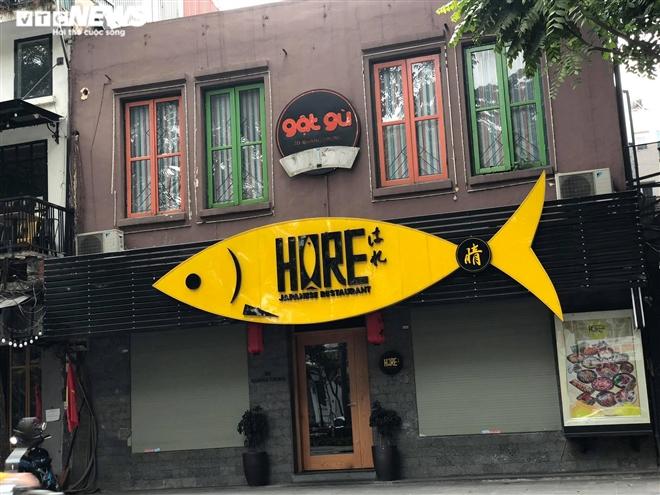 Hàng quán phố cổ Hà Nội nghỉ Tết kéo dài, khách sạn rao bán la liệt bằng tờ rơi - 17