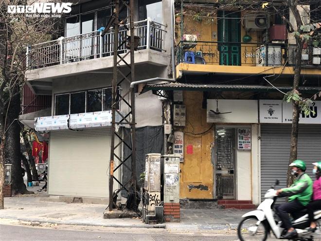 Hàng quán phố cổ Hà Nội nghỉ Tết kéo dài, khách sạn rao bán la liệt bằng tờ rơi - 18