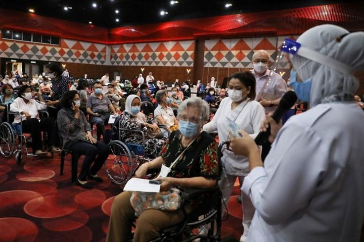Đông Nam Á tăng tốc tiêm vaccine phòng COVID-19 - 1
