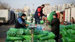 Thực phẩm Trung Quốc đắt đỏ vì lũ lụt và Covid-19
